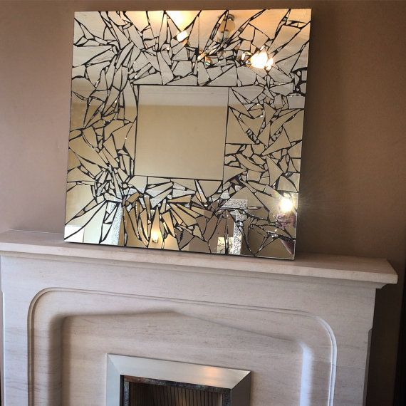Handmade mosaic mirror- interesting use of mirror and black grout. Need to use an adhesive that doesn't corrode the backing of the mirror.