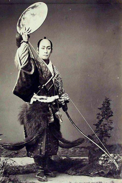 Samurai holding a yumi (bow)...