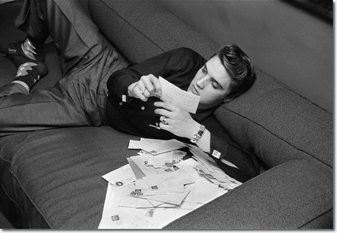 March 17, 1956, inside his suite at the Warwick Hotel in New York City, Elvis Presley finds an envelope containing dozens of fan letters that were sent to him which he proceeded to read.