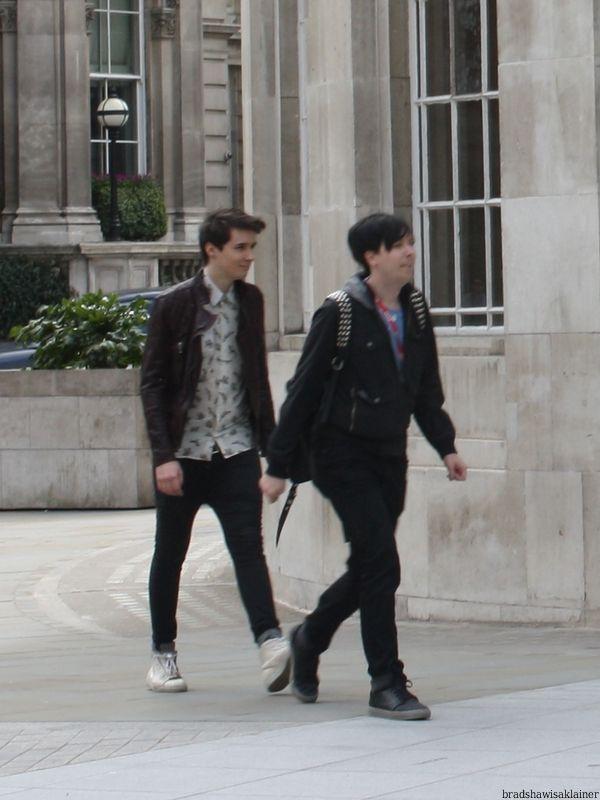 Dan and Phil walking. Dan's hair … hahaha