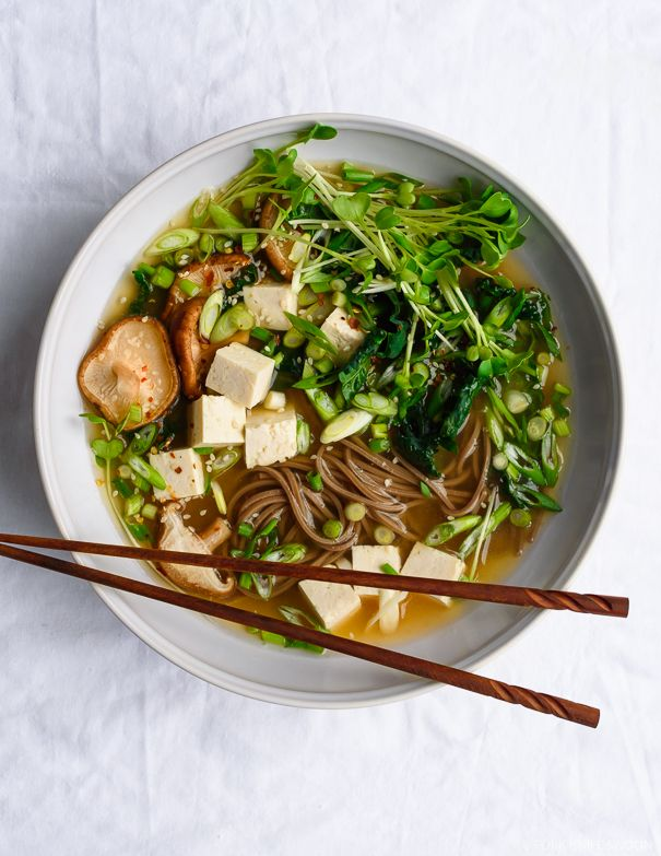 This hearty miso soup is stocked with warming garlic and ginger, swirls of buckwheat soba noodles, chunks of tofu and a heaping of veggies.