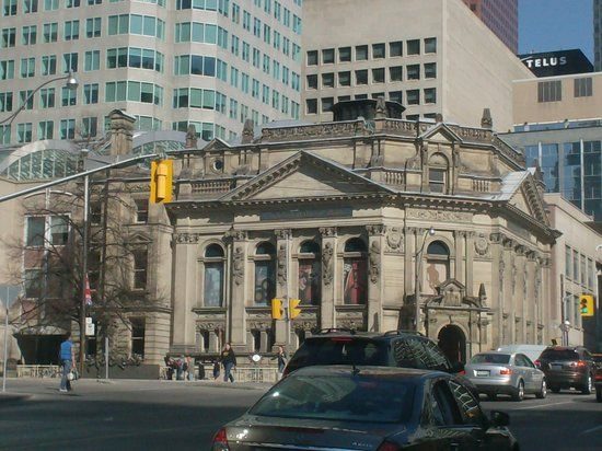 The Hockey Hall of Fame is located in Toronto, Ontario, Canada. Dedicated to the history of ice hockey, it is both a museum and a hall of fame. It holds exhibits about players, teams, National Hockey League (NHL) records, memorabilia and NHL trophies, including the Stanley Cup.