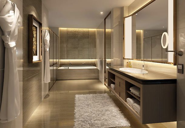 hotel bathroom Master bath, lighting, fuzzy rug, towels displayed - lighted mirror
