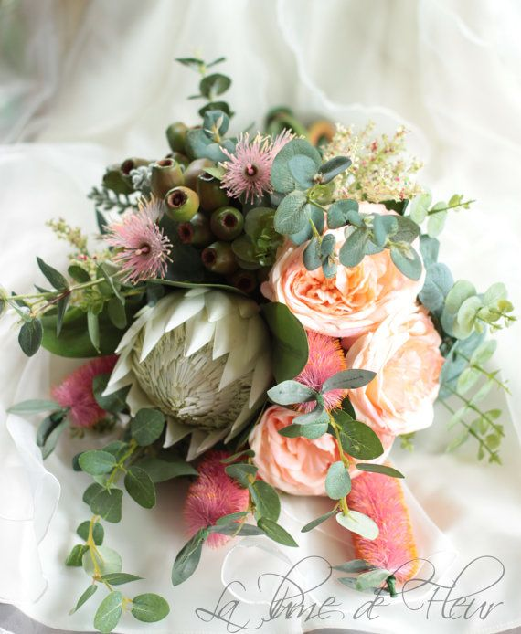 $240 on ETSY!  Ms Montville  - Bride's bouquet. Australian natives. Queen protea, roses, flowering gum, bottle brush, gumnuts.