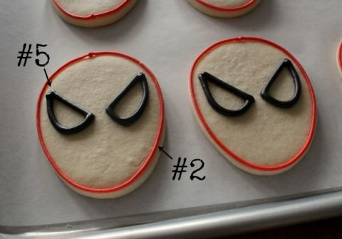 Outlining Spiderman Cookies - Visit to grab an amazing super hero shirt now on sale!