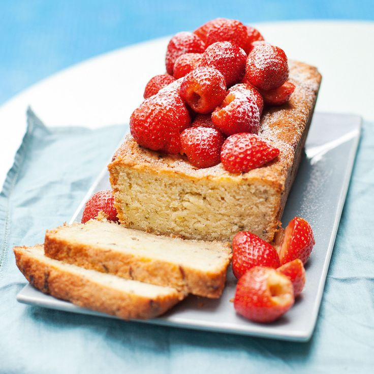 Grated courgettes add moistness to this light-as-a-feather cake recipe � just gorgeous with these boozy strawberries