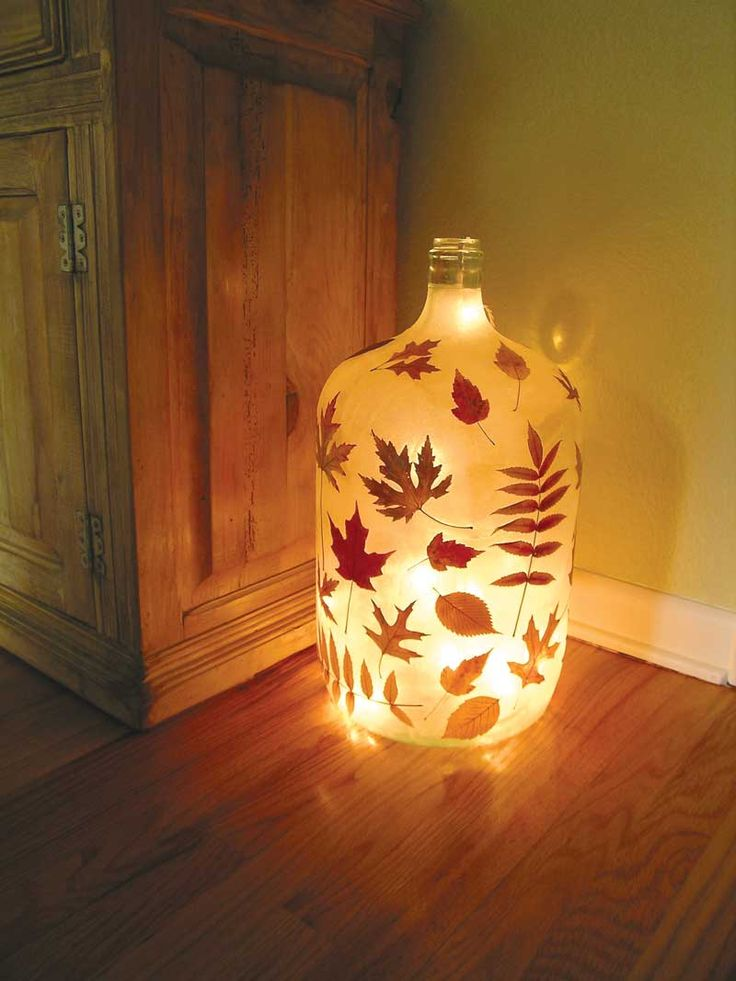 Pressed autumn leaves transforn a traditional glass bottle into a luminous vessel in this simple craft.