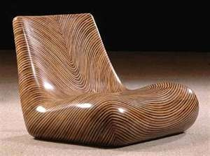 This wood chair combines organic lines with a polished look.  Beautifully streamlined.