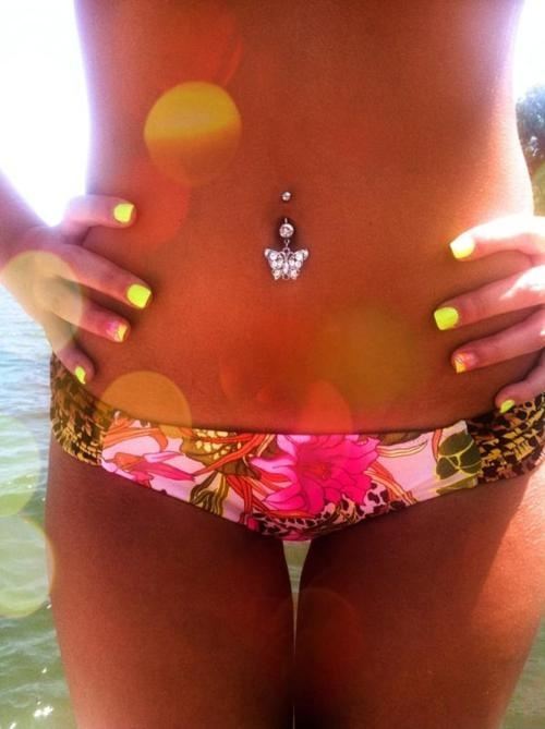 Inspirational pic: Belly ring and neon yellow nails -- totally Nikita.