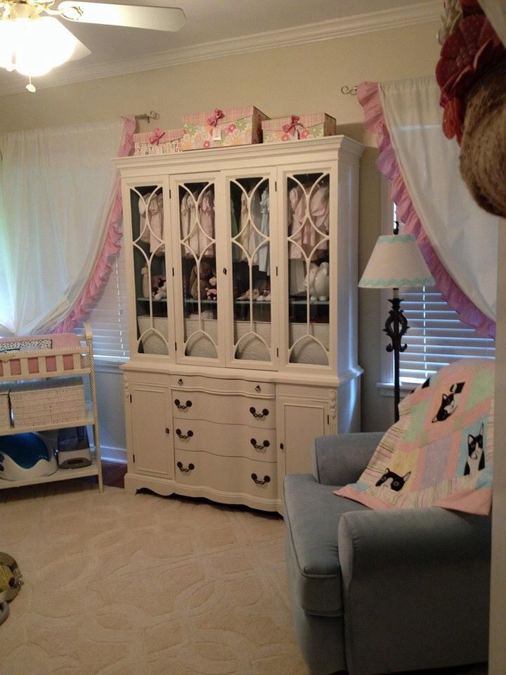 Repurposed china cabinet for nursery