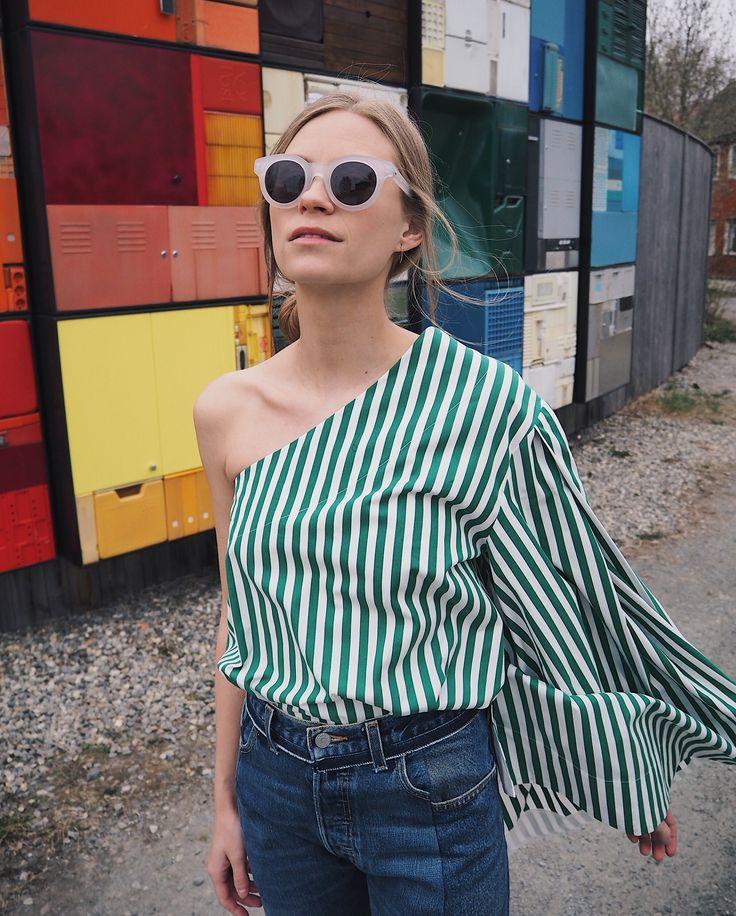 Tine Andrea Lauvli wears L.G.R Mauritania Sunglasses and Solace London Freja Green Stripe Top. Available on Style.com