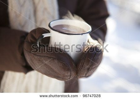 Mug of hot chocolate outdoors on a winter day