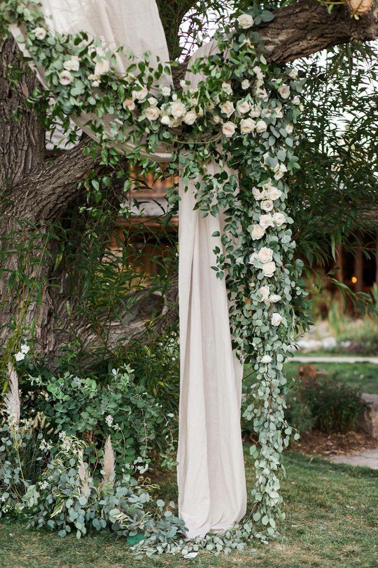 Ceremony site. Flower garland. Tree ceremony. Outdoor wedding.
