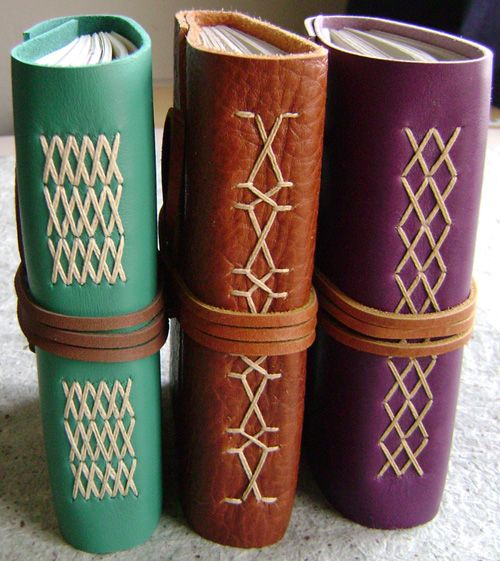 Leather journals with decorative spines by Dancing Grey Studio