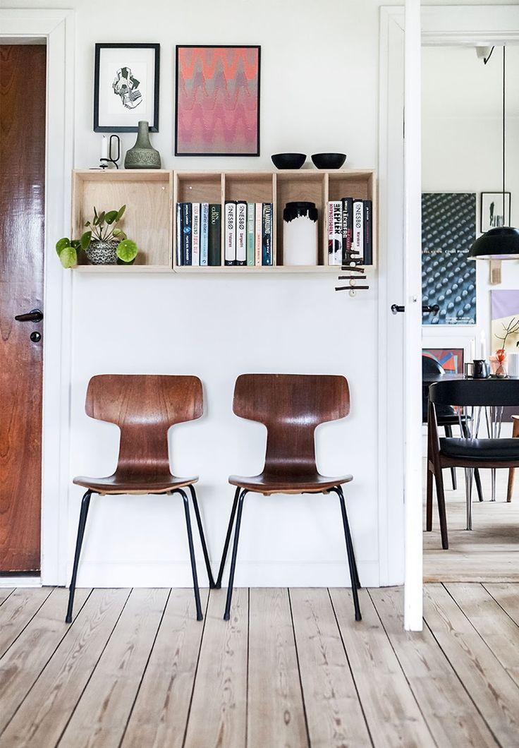 fritz hansen chairs, wall art, bookshelf, scandinavian apartment