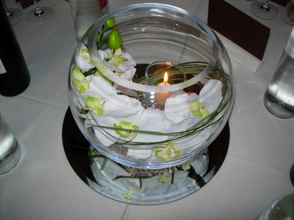 Here s an elegant centerpiece with orchids a votive