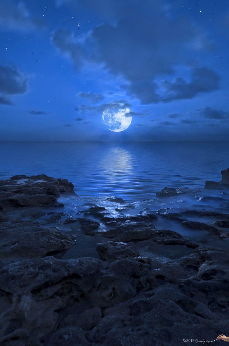 Blue Moon over rocks at Jupiter , Florida