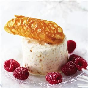 Amaretti tortoni with orange brandy snaps and raspberries recipe. These Italian-style desserts are cool enough for any occasion and most of the work is done by your freezer.