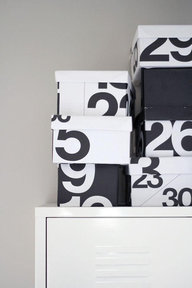 DIY - So Last Year Shoe Boxes covered in last year's wall calendar - Nice idea