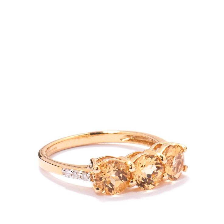 A delightful Ring from the Jacque Christie collection, set into 9k Gold featuring 1.63cts of stunning Ouro Preto Imperial Topaz from Brazil with sparkling Diamonds.