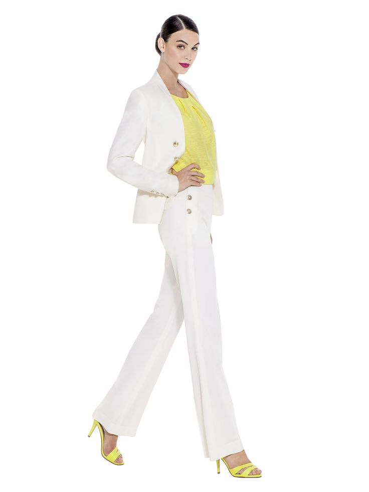 Tailored premium quality 100% Super 150's Wool and Cashmere trousers with embossed metal buttons and a high waist are a staple piece for any occasion. These trousers make the perfect companion to the matching off white tailored jacket. Fabric imported from United Kingdom: 99% Super 150's Wool 1% Cashmere Lining imported from Germany: 100% Viscose Washcare: Dry clean MADE IN EUROPE