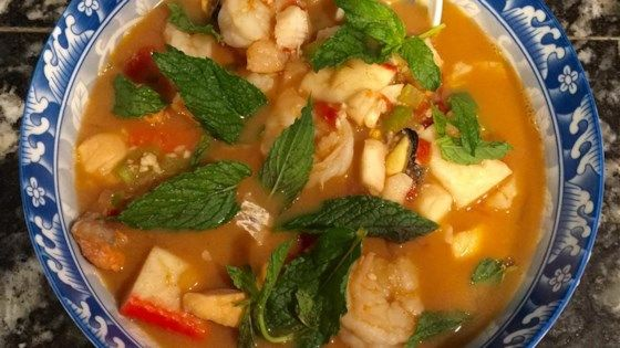 Baby shrimp and cod fillets are cooked in chicken broth with green bell peppers, chopped tomatoes, cumin and chili powder in this soup finished with plain yogurt.