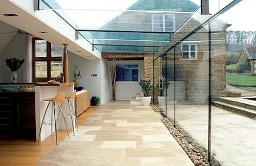 Blend new and old    NB if glass extension on one end dramatically increases light, then you can end up with other side of room looking dark - unless you balance out the lighting (i.e through adding glass velux or half height wall or additional lighting)