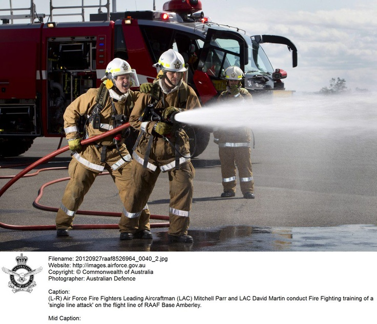 20120927raaf8526964_0043.JPG    (L-R) RAAF Fire Fighters Leading Aircraftman (LAC) Mitchell Parr and LAC David Martin conduct Fire Fighting training of a 'single line attack' on the flight line of RAAF Base Amberley. © Commonwealth of Australia