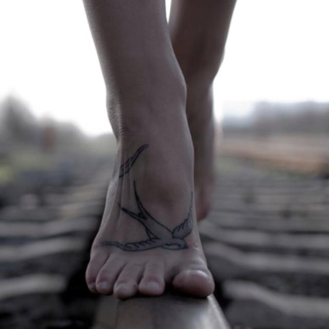 Sparrow foot tattoo