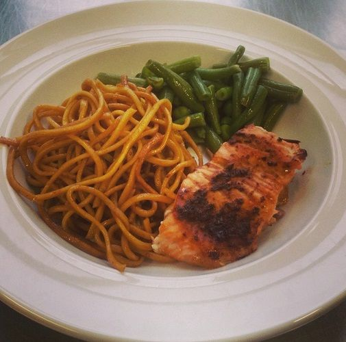 Friday lunch time at Christ Church Primary School-roast salmon in Vietnamese sauce, served with roasted green beans, peas and stir fried noodles.