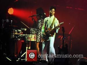 Prince performs live at the Roskilde Festival 2010