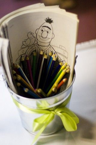 Coloring pail for kids to access at weddings and stay entertained! Like the bucket with the ribbon and the coloring page packets.