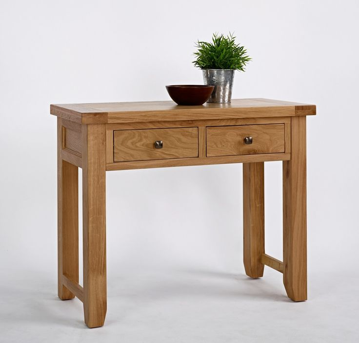 Devon Oak 2 Drawer Console Table - The Devon Oak Console Table with 2 Drawers is an elegant product crafted from the highest quality oak using artisan methods of joinery. Displaying unique knot and grain patterns, this versatile piece is provided with an attractive selection of rustic wooden or antique effect metal handles. Individual to the Devon Oak range, this piece features chamfered leg ends complete with practical floor protectors.