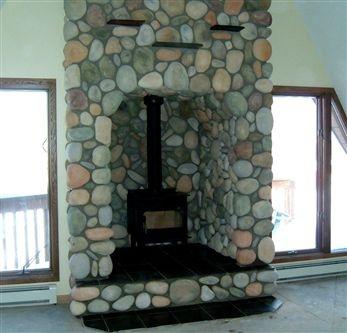 wood stove stone alcove. like the stone.