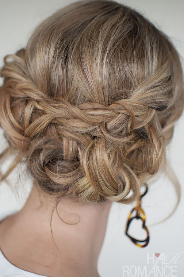 Romantic messy braid bridal hairstyle.