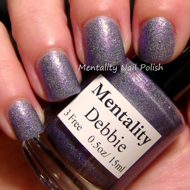 Mentality Nail Polish - Debbie is a super dense purple holographic glass fleck nail polish. This polish dries to a textured finish. For a smooth finish, use top coat.