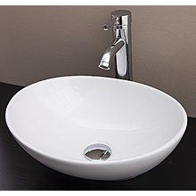 Above Counter Bathroom Vanity Oval Ceramic Basin  This attractive above-the counter basin bench-top basin is made from a ceramic construction. The basin is oval in shape and measures 400 x 330 x 140 mm.