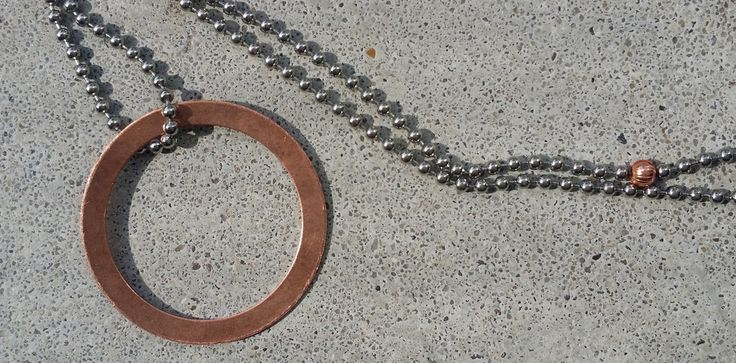 Long necklace steel with copper circle