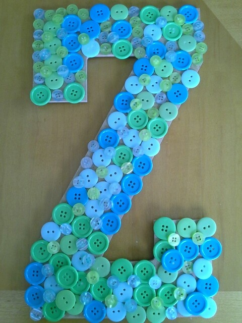 button craft on wooden letter