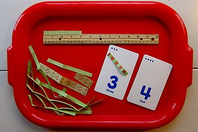 measuring ribbon -there are 12 cards which children first  lay out in order, they will then measure the ribbons and place  them on the correct cards. This cab easily be adapted for upper grade measurement concepts!