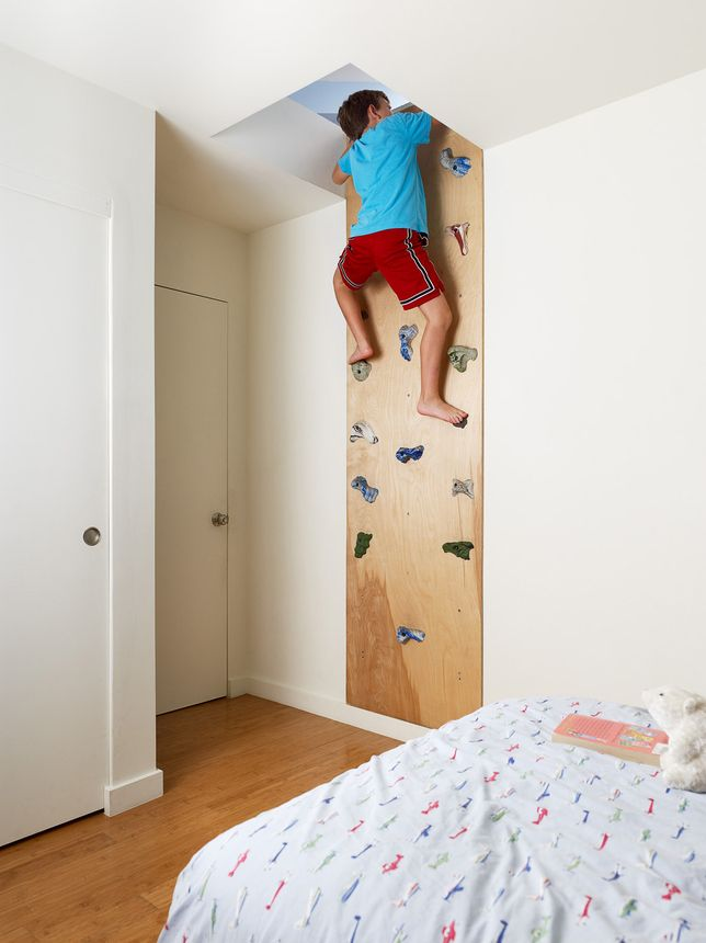 DIY cork wall with climbing pulls for the kids room. Photo by: Joe Fletcher | Read more: http://www.dwell.com/articles/Bar-Method.html