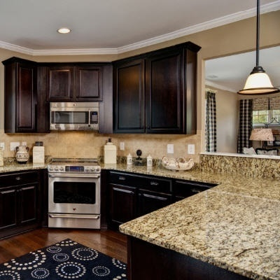 Dark cabinets and light granite counter tops & stainless steel appliances.  Yes please