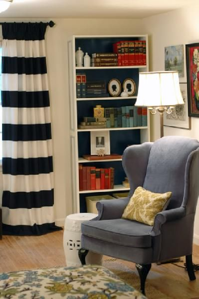 Love the window treatments, the painted bookcase, and wing chair