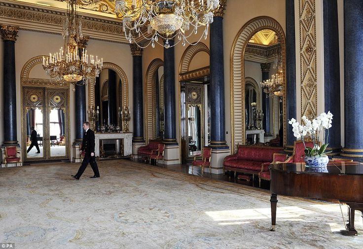 Song and dance: Palace Steward Nigel McEvoy, walks through the Music Room which has seen some of the history's finest pianists play their music on the ornate grand piano and was used during the wedding reception