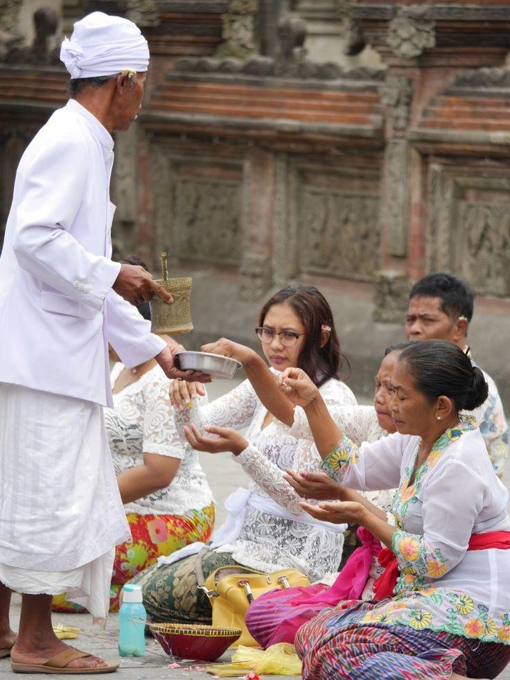 Blessings at the Pura Tirta Empul, Bali, Indonesia