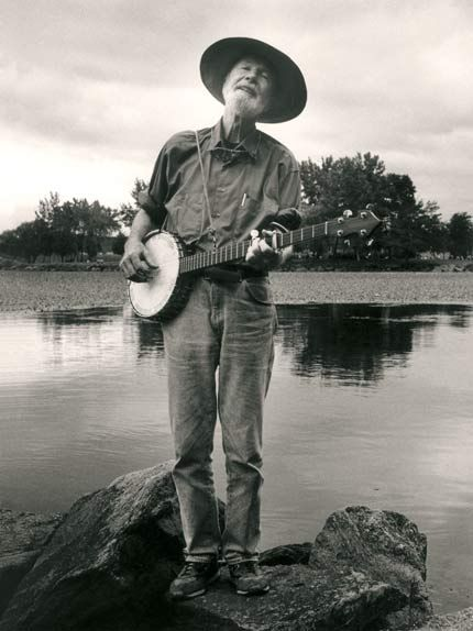 "This is Pete Seeger whose banjo reads, ""This machine surrounds hate and forces it to surrender."" Awesome."