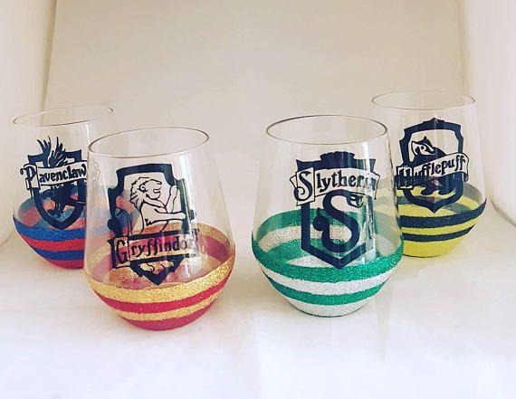 Set of four Harry potter glasses, Hogwarts house crests, stemless glasses, glitter wine glasses, glass gifts,  Harry potter glassware,