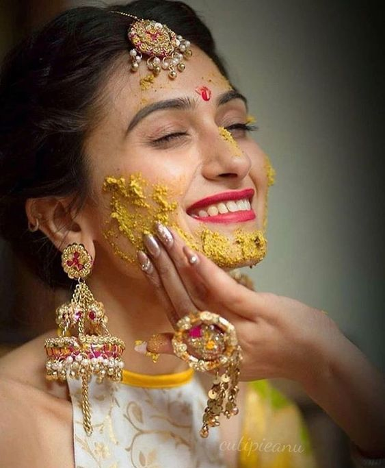 38 Must Try Haldi Ceremony Photoshoot Ideas By Raw Photography Indian Wedding Photography Haldi Ceremony Indian Wedding Photography Poses