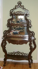 """Victorian Etagere  Antique Victorian Rococo pierce carved mirrored 4 shelf Etagere.  Beautiful piece in excellent condition.  Measures 41""""W (at the widest point) by 73""""H.  $600"""