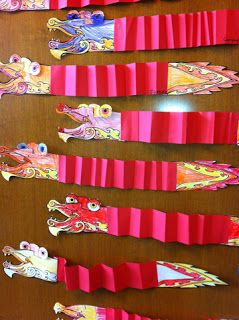 simple dragon craft, kids color in pre-drawn head and tail then accordion fold a red piece of construction paper for the body